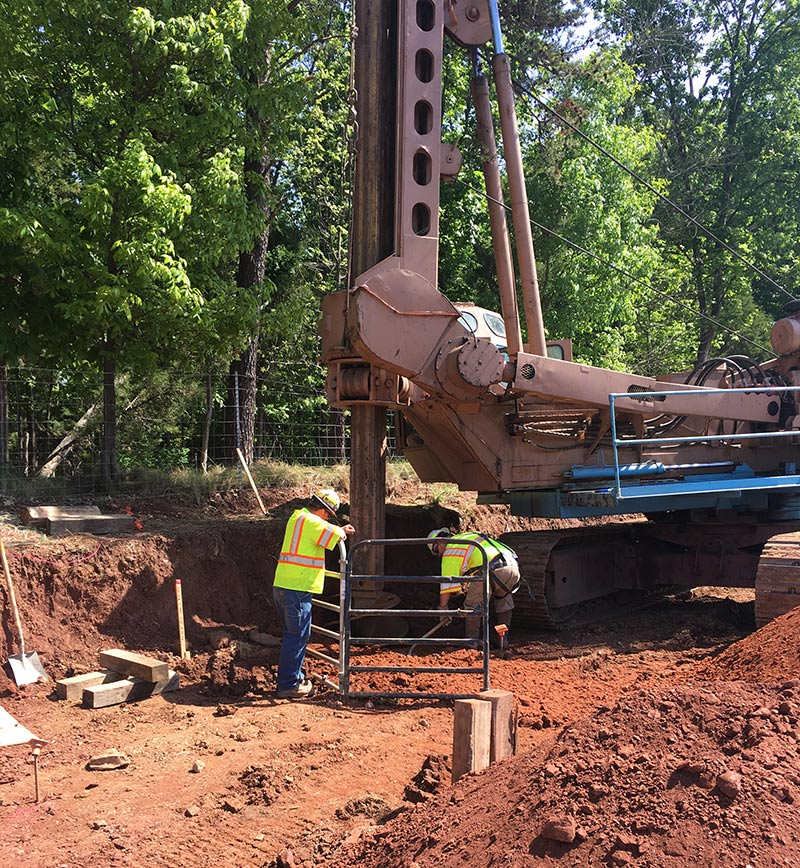 Men workong on retaining wall construction for I-66 Beltway