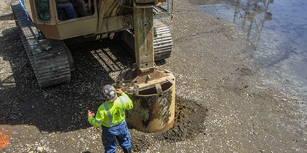 Drilling a caisson