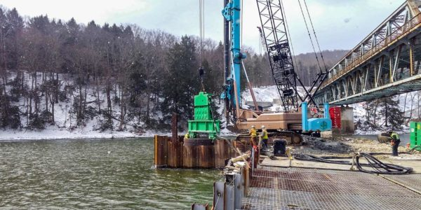 Workers drilling a drilled shaft at Hunter's Station Bridge in Tionesta, Pennsylvania