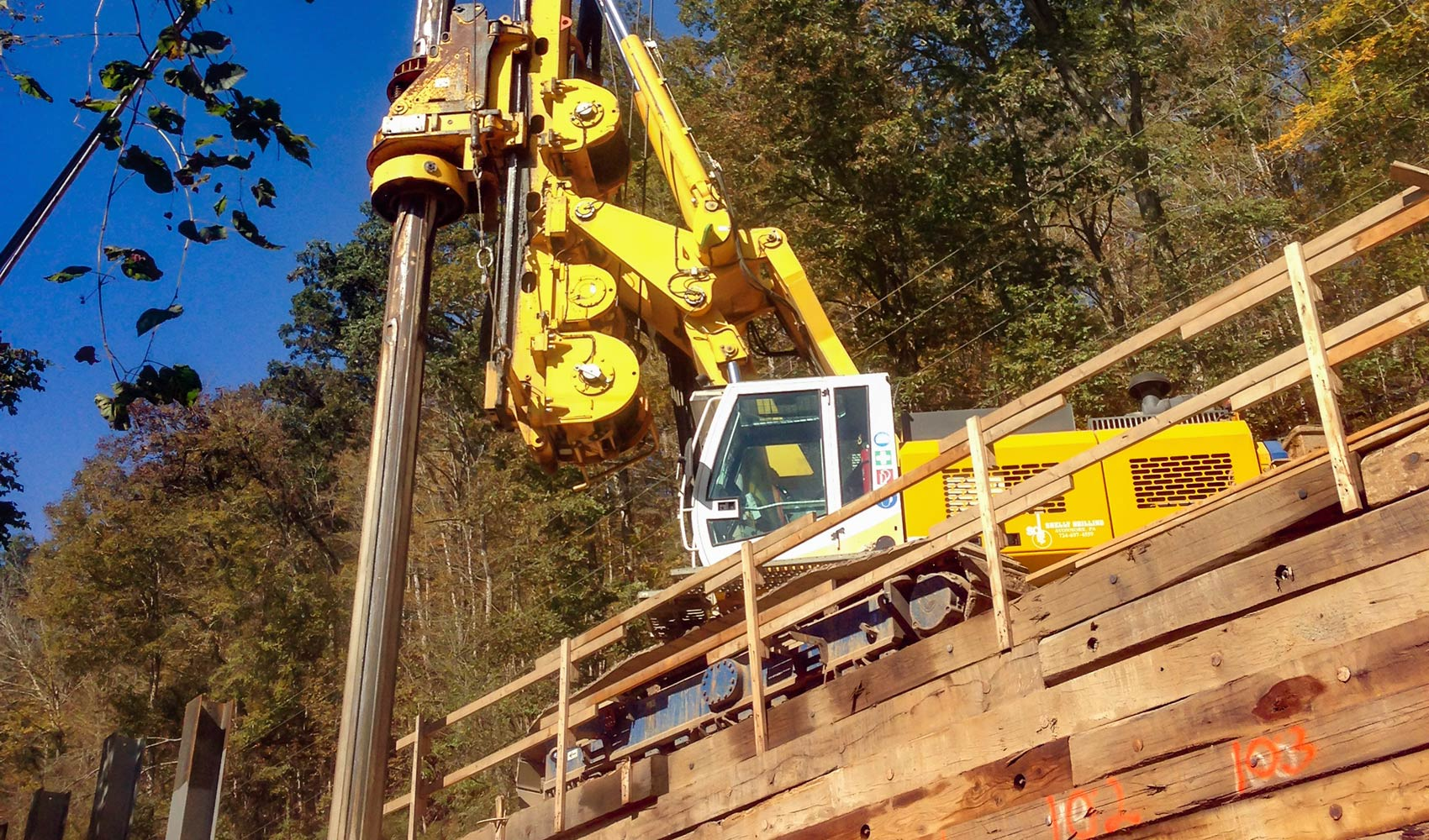 Drilling the foundation for a retaining wall
